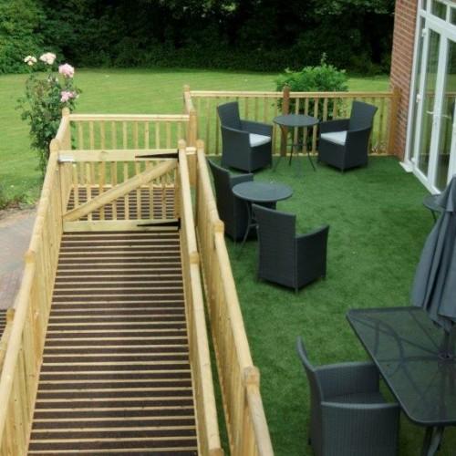 Decking area overlooking garden in Bluebell Suite